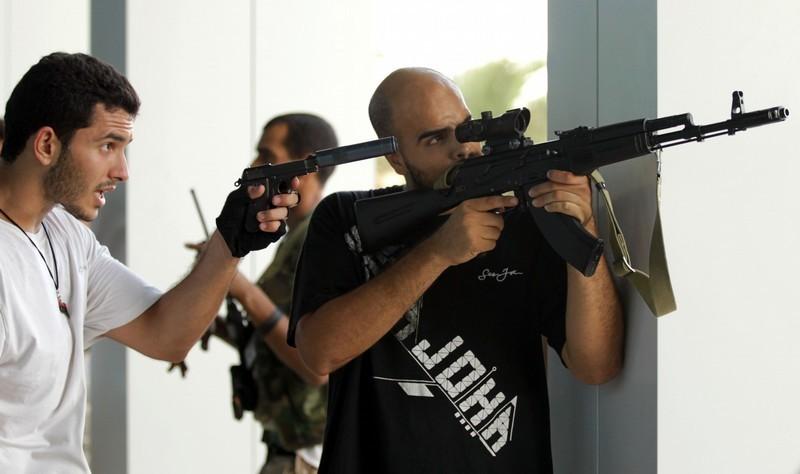 Libyan rebels conduct a search in a luxu