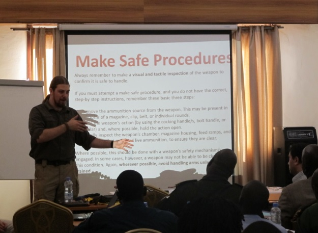 Delivering training to law enforcement and military in South Sudan (2013).
