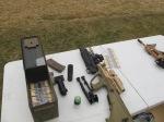 F88SA2 alongside fresh F1A1 cartridges, M1006 40x46 impact cartridge, and various accessories.