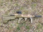 """EF88 with 16"""" barrel shown with Ase Utra suppressor, Trijicon TA44SR-10 1.5x16 ACOG, and folding foregrip."""