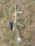 """EF88 with 20"""" barrel, fitted with Trijicon 4x32 BAC ACOG and folding foregrip."""