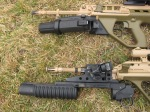 Comparison of ML40AUS (top) and M203PI (bottom) grenade launchers. Note significantly better point of balance with new GLA, and unwieldy position of quadrant sight on old GLA.