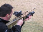 "Paul Williams test firing the ML40AUS grenade launcher mounted on a 20"" barrel EF88. Note convenient, level placement of quadrant sight and mounted Trijicon RMR to left of ACOG."