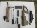 """EF88 with 16"""" barrel broken down into major component groups. Note hammer pack and retaining pin/rear sling swivel at centre. Ase Utra suppressor and ML40AUS grenade launcher also shown."""